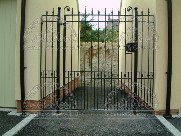 Gate with side panels between garages. Devon